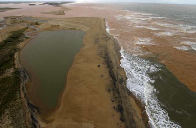 A general view the mouth of Rio Doce (Sweet River), which was flooded with mud after a dam owned by Vale SA and BHP Billiton Ltd burst, as the river joins the sea on the coast of Espirito Santo in ...