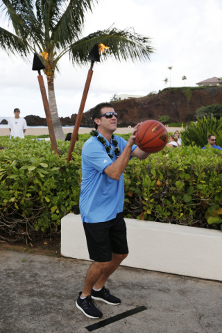 Nov 22, 2015; Maui, HI, USA; UCLA coach Steve Alford shoots a free throw in the the coaches charity free throw competition during the Maui Jim Maui Invitational press conference at the Sheraton Ma ...