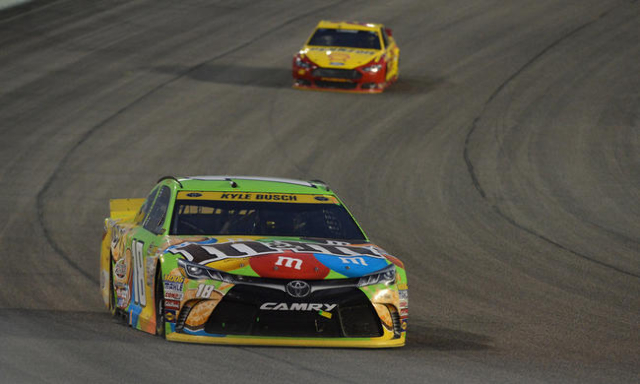 Nov 22, 2015; Homestead, FL, USA; NASCAR Sprint Cup Series driver Kyle Busch leads Joey Logano during the Ford EcoBoost 400 at Homestead-Miami Speedway. Mandatory Credit: Jasen Vinlove-USA TODAY S ...