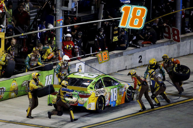 Nov 22, 2015; Homestead, FL, USA; Sprint Cup Series driver Kyle Busch (18) makes a pit stop during the Ford EcoBoost 400 at Homestead-Miami Speedway. Mandatory Credit: Peter Casey-USA TODAY Sports