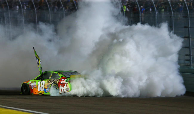 Nov 22, 2015; Homestead, FL, USA; NASCAR Sprint Cup Series driver Kyle Busch celebrates with a burnout after winning the Ford EcoBoost 400 to win the Sprint Cup championship at Homestead-Miami Spe ...