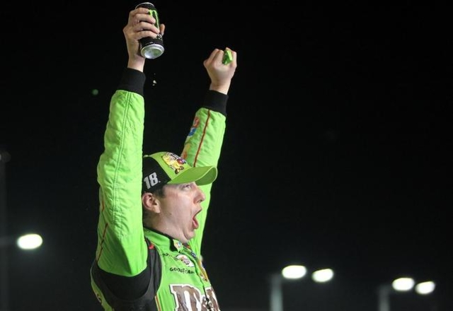 Nov 22, 2015; Homestead, FL, USA; Sprint Cup Series driver Kyle Busch (18) celebrates winning the NASCAR Spring Cup Championship after the Ford EcoBoost 400 at Homestead-Miami Speedway. Mandatory  ...