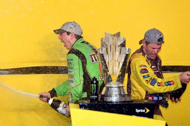 Sprint Cup Series driver Kyle Busch, left, celebrates after winning the NASCAR Sprint Cup Champion after the Ford EcoBoost 400 at Homestead-Miami Speedway, Nov 22, 2015. (Jasen Vinlove-USA TODAY S ...