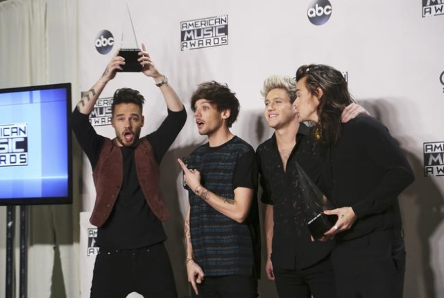 One Direction poses backstage with their awards for Favorite Rock/Pop Band/Duo/Group and Artist of the Year during the 2015 American Music Awards in Los Angeles, California November 22, 2015.  REU ...