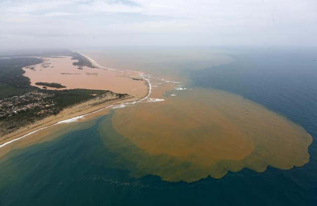 An aerial view of the Rio Doce (Sweet River), which was flooded with mud after a dam owned by Vale SA and BHP Billiton Ltd burst, at an area where the river joins the sea on the coast of Espirito  ...