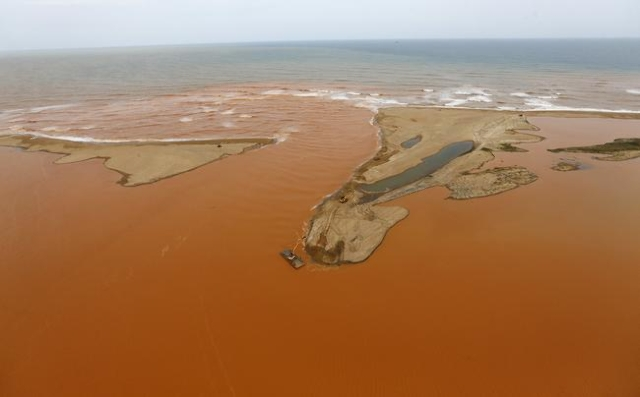 An aerial view of the mouth of Rio Doce (Sweet River), which was flooded with mud after a dam owned by Vale SA and BHP Billiton Ltd burst, at an area where the river joins the sea on the coast of  ...