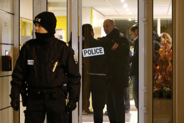 French police cordon the area after an alleged explosive belt was found in Montrouge, near Paris, a week after a series of deadly attacks in the French capital Paris, France, November 23, 2015. (E ...