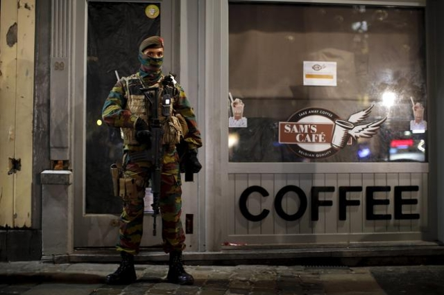 Belgian soldiers patrol in central Brussels as police searched the area during a continued high level of security following the recent deadly Paris attacks, Belgium, November 23, 2015. (Benoit Tes ...
