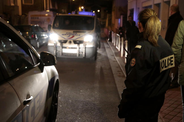 French police cordon the area after an alleged explosive belt was found in Montrouge, near Paris, a week after a series of deadly attacks in Paris, France, November 23, 2015. (Eric Gaillard/Reuters)