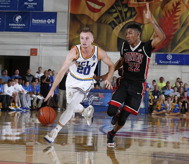 Nov 23, 2015; Lahaina, HI, USA; UCLA Bruins guard Bryce Alford (20) takes a shot against  UNLV Runnin Rebels guard Patrick McCaw (22) at the Lahaina Civic Center during the Maui Jim Maui Invitatio ...