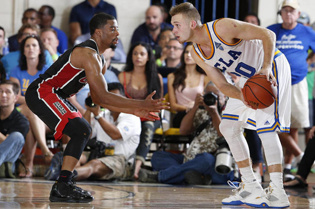 Nov 23, 2015; Lahaina, HI, USA; UCLA Bruins guard Bryce Alford (20) is guarded by UNLV Runnin Rebels guard Jerome Seagears at the Lahaina Civic Center during the Maui Jim Maui Invitational at the  ...