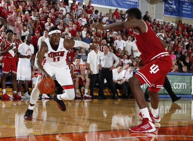 Nov 25, 2015; Lahaina, HI, USA; UNLV Runnin Rebels forward Goodluck Okonoboh  (11) drives to the basket against Indiana Hoosiers center Thomas Bryant (31) during the Maui Jim Maui Invitational at  ...