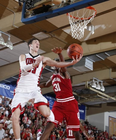 Nov 25, 2015; Lahaina, HI, USA; UNLV Runnin Rebels center Stephen Zimmerman Jr.   (33) takes a shot against Indiana Hoosiers center Thomas Bryant (31) during the Maui Jim Maui Invitational at the  ...