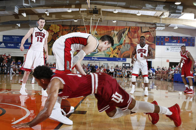 Indiana Hoosiers guard James Blackmon Jr. (1) loses control of the ball to UNLV Runnin Rebels center Stephen Zimmerman Jr. (33) during the Maui Jim Maui Invitational at the Lahaina Civic Center. ( ...