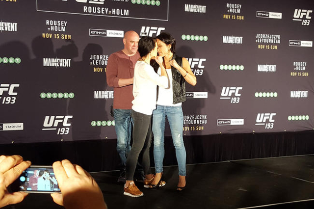 UFC women's strawweight champion Joanna Jedrzejczyk, left, locked in an intense staredown with challenger Valerie Letourneau during media day Friday at Etihad Stadium in Melbourne, Australia ...