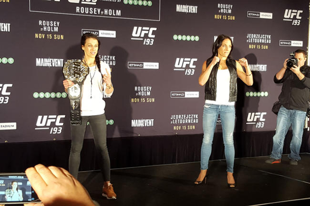 UFC women's strawweight champion Joanna Jedrzejczyk, left, poses with her belt alongside challenger Valerie Letourneau during media day Friday at Etihad Stadium in Melbourne, Australia, for  ...