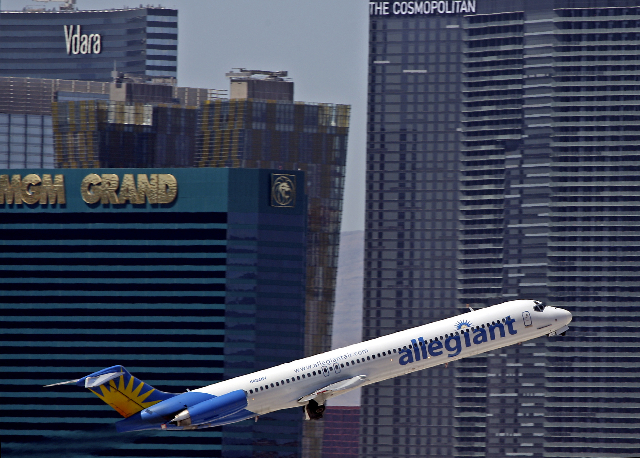 An Allegiant Air jetliner takes off from McCarran International Airport with a view of the Las Vegas Strip in the background. (John Gurzinski/Las Vegas Review-Journal)