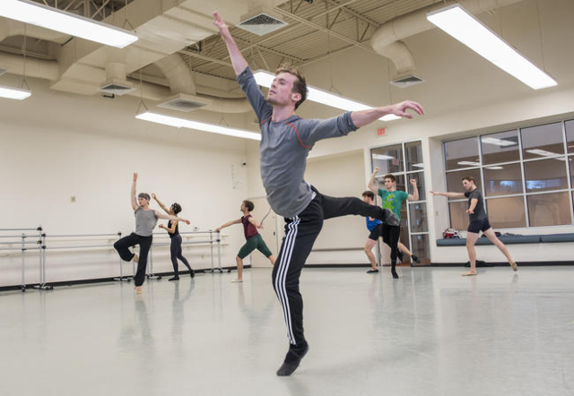 Nevada Ballet Theatre company artist Braeden Barnes, center, along with other company artists practice new choreography moves for a gala performance at The Smith Center from the Nevada Ballet Thea ...