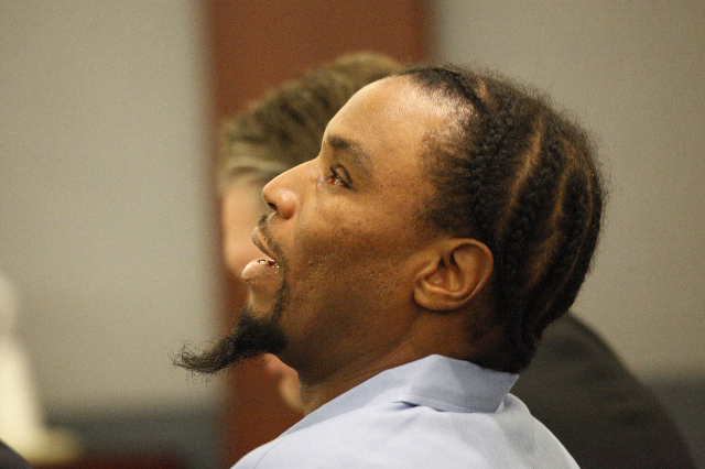LeSean Collins, accused of the 2008 murder of Brandi Payton, listens during opening statements in his case at the Regional Justice Center in Las Vegas Monday, August 3, 2015. (Erik Verduzco/Las Ve ...