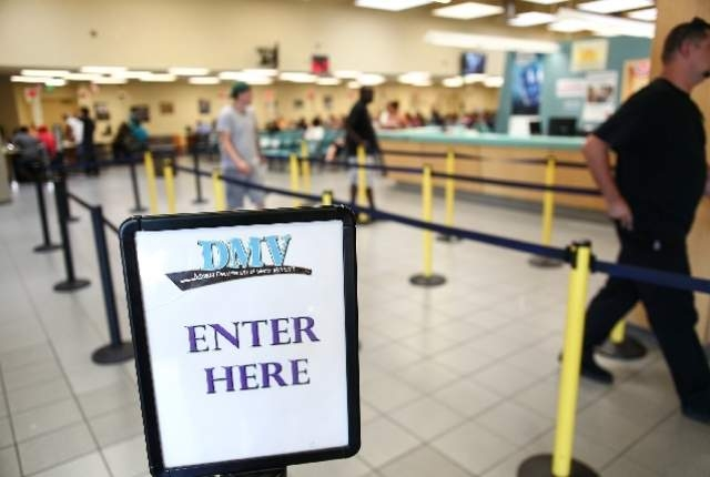 People walk through the info line at the DMV office at 2701 E. Sahara Ave., in Las Vegas. (Las Vegas Review-Journal file)