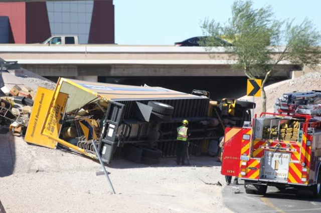 The I-15 northbound ramp onto northbound Highway 95 is blocked by a truck rollover. (Bizuayehu Tesfaye/Las Vegas Review-Journal)