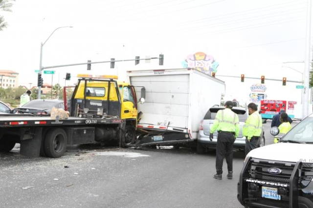 Two people were hospitalized after a multivehicle crash at Rancho Drive and Smoke Ranch Road, Tuesday, Oct. 10, 2015. (Bizuayehu Tesfaye/Las Vegas Review-Journal Follow @bizutesfaye)