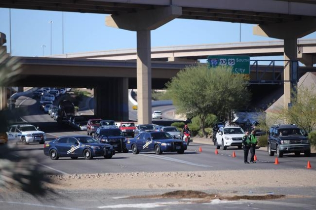 NHP directs traffic around the site of a one vehicle crash on eastbound Lake Mead Parkway near the Fiesta Henderson Casino on Saturday, Nov. 14, 2015 in Henderson, Nev. (Brett LeBlanc/Las Vegas Re ...