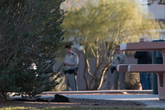 Metro and Clark County School District police officers on Saturday Nov. 7, 2015,  investigate in the parking lot at Desert Bloom Park where James Smyth was shot and killed by school police the pre ...