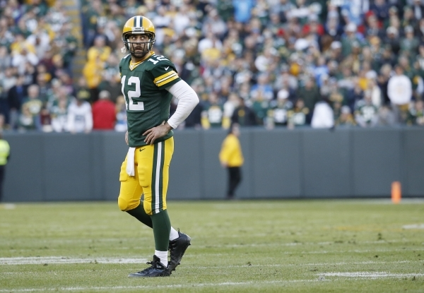 Green Bay Packers' Aaron Rodgers looks back as he walk off the field during the second half of an NFL football game against the Detroit Lions Sunday, Nov. 15, 2015, in Green Bay, Wis. The Li ...