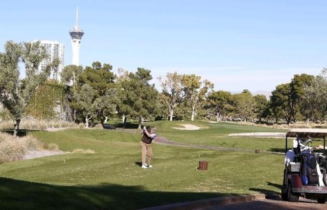A golfer is seen hitting his tee shot near the 18th hole at the Las Vegas Country Club on 3000 Joe W. Brown Drive, Friday, Nov. 20, 2015. Bizuayehu Tesfaye/Las Vegas Review-Journal Follow @bizutes ...