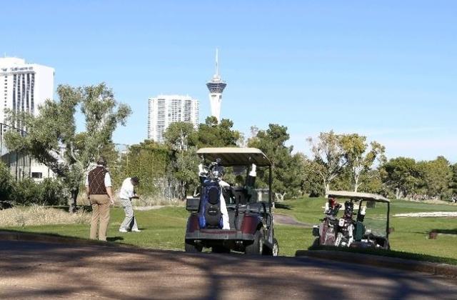 Golfers are seen hitting their tee shot near the 18th hole at the Las Vegas Country Club on 3000 Joe W. Brown Drive, Friday, Nov. 20, 2015.. (Bizuayehu Tesfaye/Las Vegas Review-Journal) Follow @bi ...
