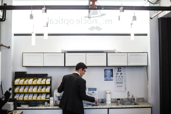 Eric Healey, owner of Monocle Optical, works on a pair of glasses at his business on the third floor of the Container Park in downtown Las Vegas on Thursday, Nov. 12, 2015. (Chase Stevens/Las Vega ...