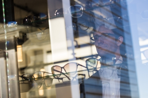 Eric Healey, owner of Monocle Optical, poses for a portrait at his business on the third floor of the Container Park in downtown Las Vegas on Thursday, Nov. 12, 2015. (Chase Stevens/Las Vegas Revi ...