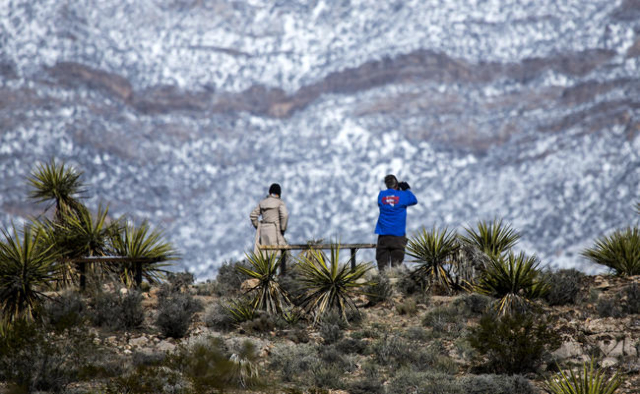 A couple takes in a view of the Red Rock Canyon National Conservation Area on Tuesday, Feb 24, 2015. At the time the photo was taken the Loop was closed because of weather conditions. (Jeff Scheid ...