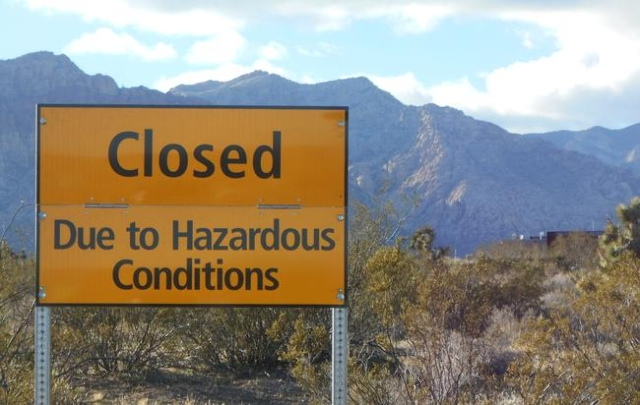 Barbed wire installed at entry gate on SR 159. Hazardous conditions sign posted. (Alan Snel/Las Vegas Review-Journal)
