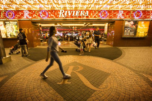 People walk in front of the Riviera hotel-casino on the Las Vegas Strip, April 20,2015.  (Jeff Scheid/Las Vegas Review-Journal Follow @jlscheid)