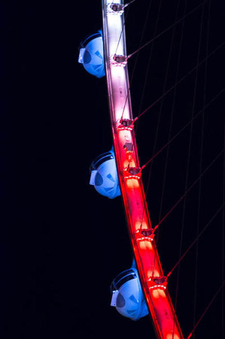 The High Roller at The Linq is lit blue, white and red, in homage to France, on Friday after the deadly terror attacks in Paris.  (Ricardo Torres/Las Vegas Review-Journal)