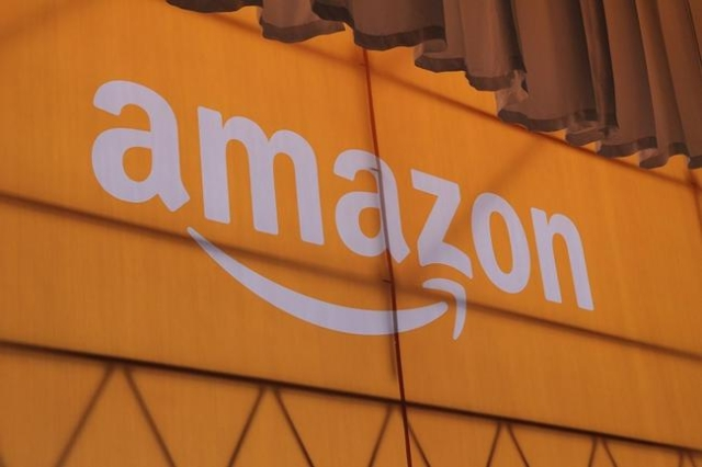 A new, high-definition Kindle with a lighting system and a bigger Kindle Fire tablet topped the list of gadgets rolled out by Amazon on Thursday. CEO Jeff Bezos unveiled the products at a Santa Mo ...