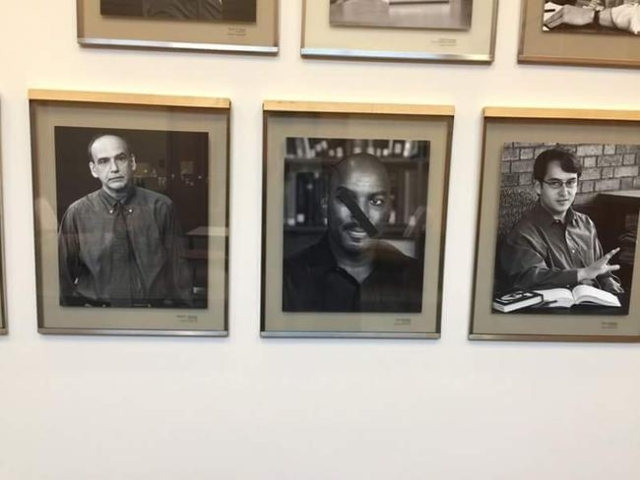 African American professors' photographs at Harvard's law school were defaced in an incident being investigated as a hate crime. (A.J. Clayborne/CNN)