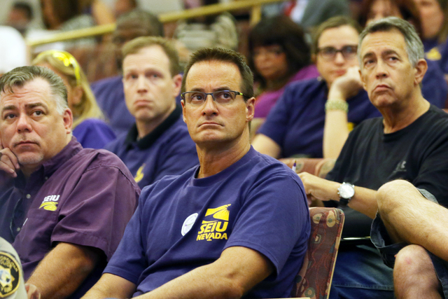 Service Employees International Union Local 1107 members and supporters, wearing purple shirts, wait for public comment to take place during the County Commission meeting at Clark County Governmen ...