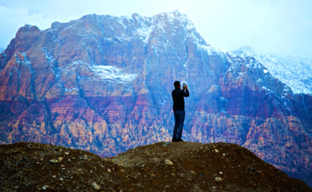 A man takes a photo at sunset  on Monday, March 2, 2014 of Red Rock Canyon National Conservation Area.(Jeff Scheid/Las Vegas Review-Journal)