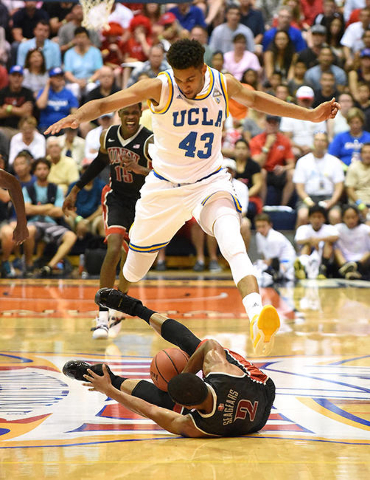 UCLA's Jonah Bolden leaps over UNLV's Jerome Seagears in the first half of their Maui Jim Maui Invitational game at Lahaina Civic Center Monday evening. photo by Matthew Thayer / The Maui News