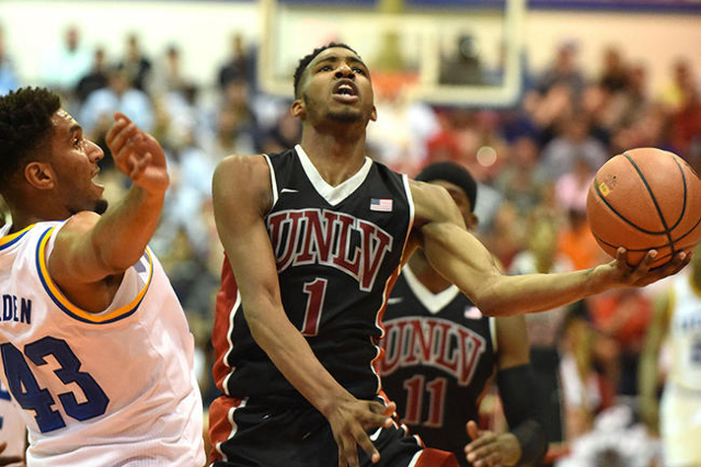 UNLV's Derrick Jones Jr. drives against UCLA's Jonah Bolden in the first half of their Maui Jim Maui Invitational game at Lahaina Civic Center Monday evening.  photo by Matthew Thayer / The Ma ...