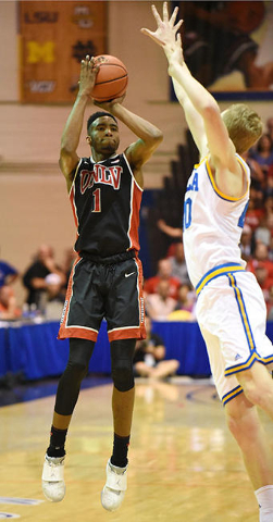 UNLV's Derrick Jones Jr. shoots in front of UCLA's Jonah Bolden in the first half of their Maui Jim Maui Invitational game at Lahaina Civic Center Monday evening.  photo by Matthew Thayer / Th ...