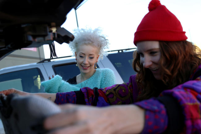 Michelle Kolnik, AKA Crykit,  and her regular model and friend Alexandria Bell sort through thrifted clothes during a photo shoot on California Avenue Friday, Nov. 6, 2015 in Las Vegas. Photo by R ...