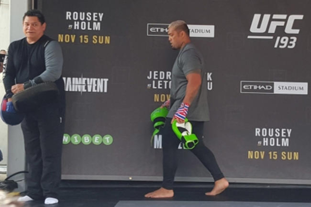 """eavyweight Mark Hunt walks off stage after hitting pads for fans at open workouts for UFC 193 in Melbourne on Sunday where he will have a rematch against Antonio """"Bigfoot"""" Silva. Adam Hi ..."""