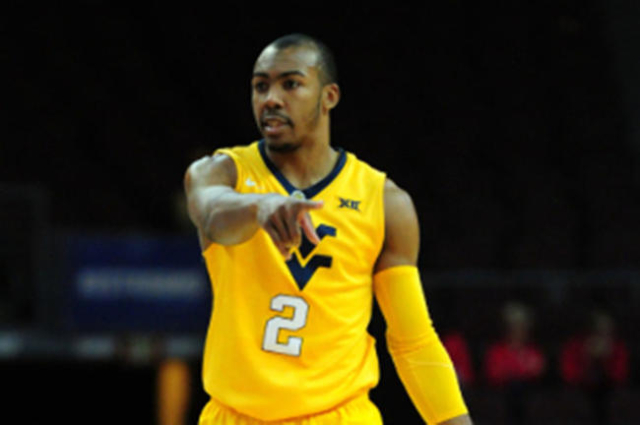 West Virginia's Carter hopes to make smooth transition to point ...