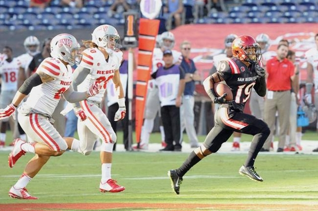 San Diego State running back Donnel Pumphrey scores the first of four touchdowns on Saturday, Sept. 27, 2014 in San Diego. The Aztecs beat UNLV 34-17. (Ernie Anderson/SDSU Media Relations)