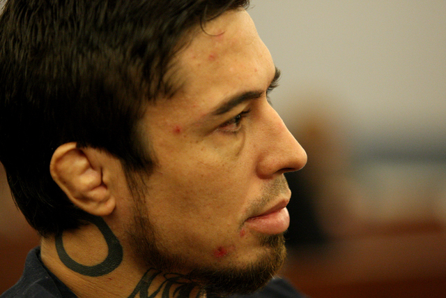 Jonathan Koppenhaver, aka War Machine, listens to testimony from his ex-girlfriend, Christy Mack, during a preliminary hearing at the Las Vegas Regional Justice Center on Friday, Nov. 14, 2014. (M ...