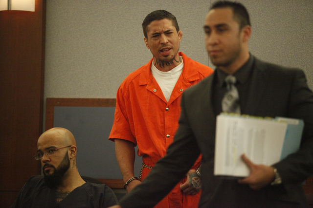 Former mixed martial artist Jonathan Koppenhaver, also known as War Machine speaks with his lawyer Brandon Sua as they appear before Judge Elissa Cadish on Wednesday, June 3, 2015 in Las Vegas. Wa ...